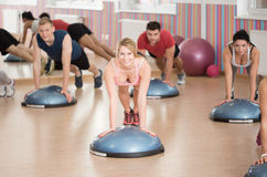 Push-ups on bosu. Fit people doing push-ups on fitness bosu Royalty Free Stock Image