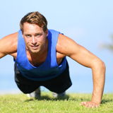 Push ups - fitness man exercising push up outside Royalty Free Stock Photography