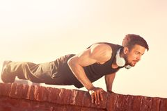 Man Doing Push-Ups. Push ups, fitness in nature, handsome man and a healthy lifestyle stock photos