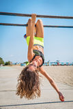 Push-ups fitness woman doing pushups outside on beach. Fit female sport model girl training crossfit outdoors. Royalty Free Stock Photo