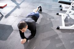 Push-ups in the gym. Disabled athlete has push-ups on the floor in sport club royalty free stock image