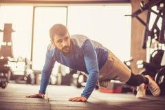 Push-ups at gym. royalty free stock image