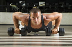 Push ups leaning on weigths Royalty Free Stock Images