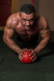 Push-ups on Medicine Ball Stock Image