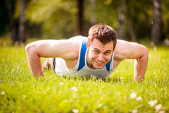 Push ups in nature Royalty Free Stock Images