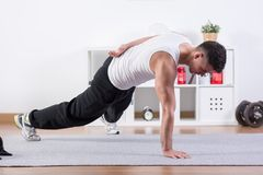 Push-ups on one hand. Strong man doing push-ups on one hand Stock Photography