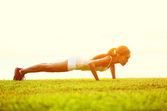 Push Ups Or Press Ups Exercise By Young Woman Stock Photos