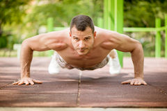 Push-Ups In The Park Stock Photos