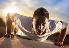 Push ups. Picture of a young athletic man doing push ups outdoors.Keeping fit for a healthy mind and body. Fitness and exercising outdoors urban environment stock images