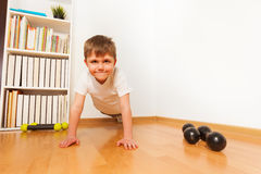 Push-ups or press-ups exercise by preschooler boy Stock Image