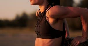 Female Athlete Doing Push Ups On Beach. stock footage