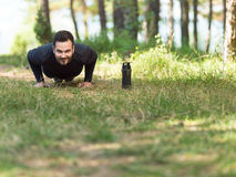 Push ups sport fitness man doing push-up. S. Male athlete exercising Stock Photography