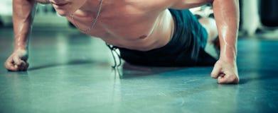 Push ups. Push up at warehose floor at training room stock photo