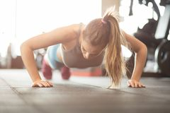 Push-ups. Woman at gym. stock photos