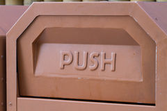 Push word on bin hinge Royalty Free Stock Photography