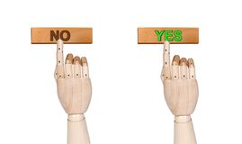 Push yes and no. Wooden hands pushing yes and no button isolated on white Stock Photo
