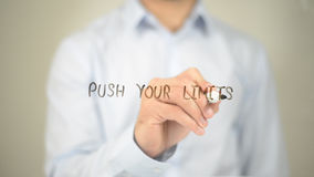 Push your Limits , Man writing on transparent screen Royalty Free Stock Image