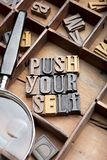 Push yourself. In wooden typeset letters on rustic background royalty free stock photos