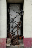 Pushbike in doorway. A well secured pushbike Stock Photo