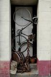 Pushbike in doorway. stock photo
