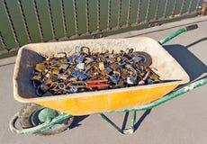Pushcart with cut padlocks Royalty Free Stock Image