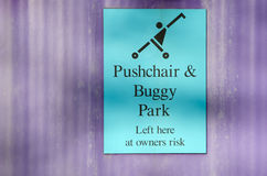 Pushchair and buggy park sign. On purple background Stock Images