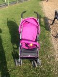 Pushchair. Pink baby Stock Photo