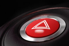 Pushed red hazard warning button Stock Photo