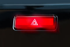 Pushed red warning button with triangle pictogram and flasher li Stock Images