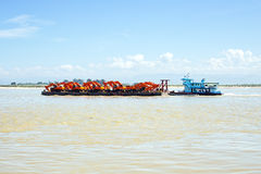 Pusher with cranes on the Ayarwaddi river in Myanmar Stock Photography
