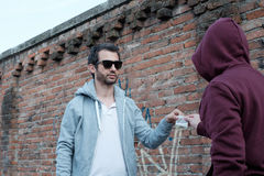 Pusher and drug addict exchanging money and drug Stock Photo