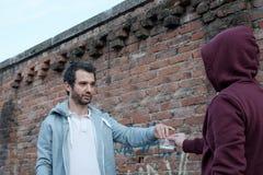 Pusher and drug addict exchanging money drug Stock Photo