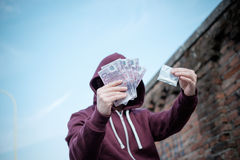 Pusher selling and trafficking drug dose. For money cash Royalty Free Stock Images