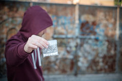 Pusher selling and trafficking drug dose Stock Images