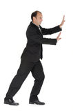 Pushing. A businessman pushing something away Royalty Free Stock Photography