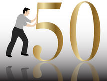 Pushing the 50 congratulation. A man pushing the 50 congratulation Royalty Free Stock Photo