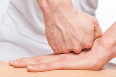 Pushing against sports massage, masseur`s hands. Closeup Stock Photos