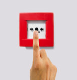 Pushing the alarm to activate it. A hand of man standing over the alarm lever to activate it royalty free stock photo