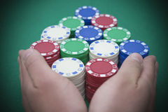 Pushing all the casino chips out Royalty Free Stock Images
