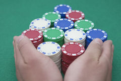 Pushing all the casino chips out for the final round. Show hand Stock Photography