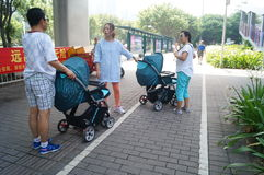 Pushing baby carriages on the sidewalk in Shenzhen, China Royalty Free Stock Photo