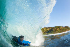 Pushing through the barrel. A body boarder getting barreled Royalty Free Stock Photography