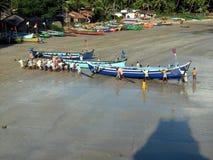 Pushing a Boat Stock Photo