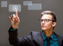 Pushing a button in a digital world. Young european male model is pushing a digital touchscreen buitton Stock Image