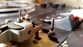 Pushing Button on a old Tape Recorder, Play. Rotation reel with tape on the video, audio tape recorder player. Closeup stock video footage