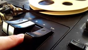 Pushing Button on a Tape Recorder, Play,. Rotation reel with tape on the video, audio tape recorder player. Closeup stock video footage