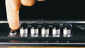 Pushing Buttons on a Tape Recorder, Play, Stop, Rec, ff, Rew. Close-up. Male Finger Pushing a Button Play. Man finger presses playback control buttons on audio stock footage