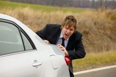 Pushing car Royalty Free Stock Images