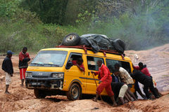 Pushing the car out of mud Stock Image