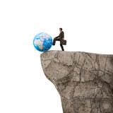 Pushing Earth of a cliff Stock Image